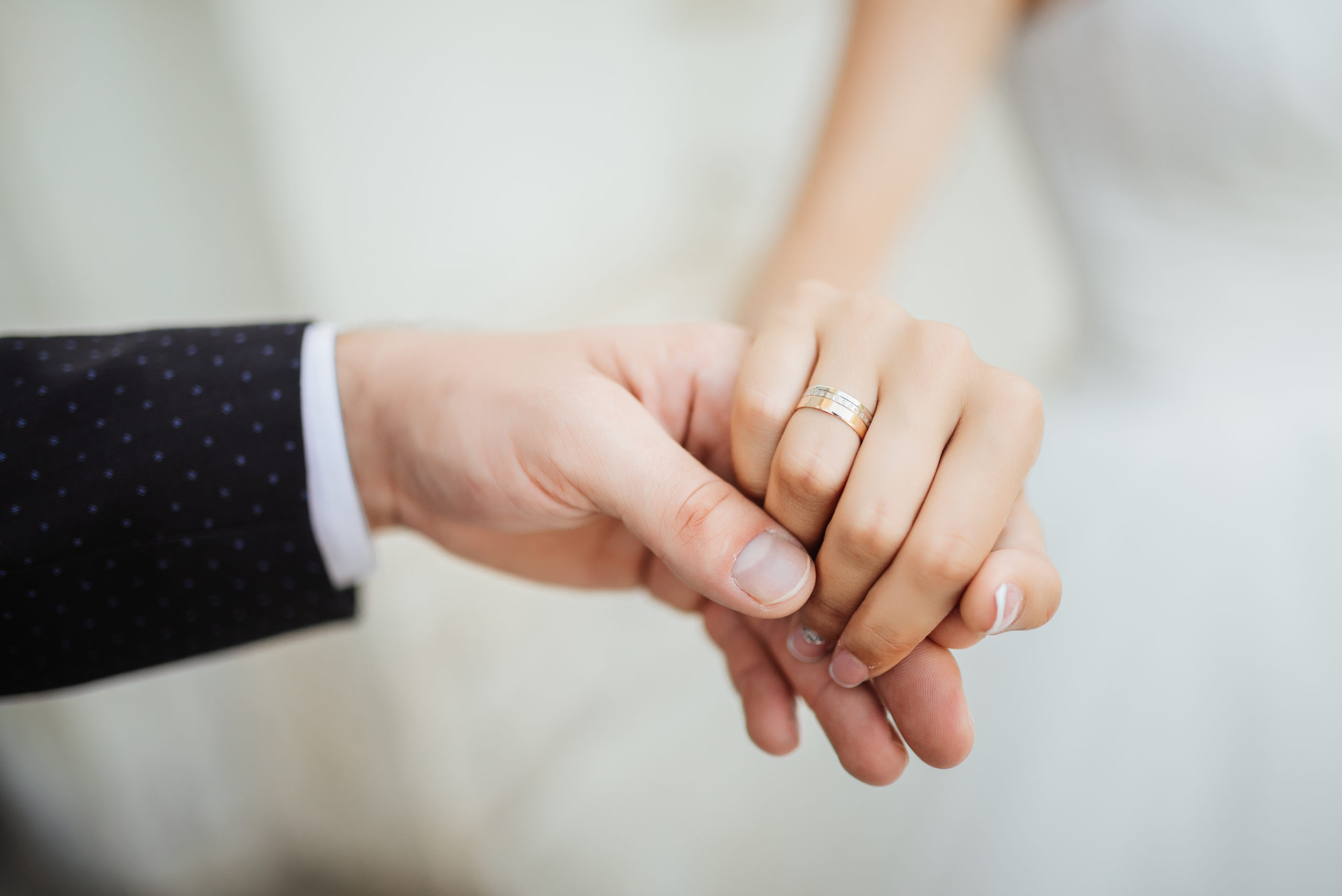 Wedding moments. Newly wed couple's hands with wedding rings