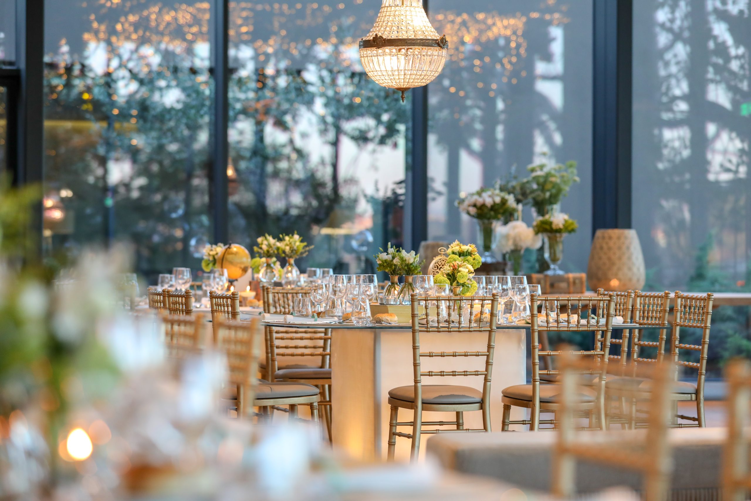 Decorated wedding hall with a beautiful table setting with floral decorations